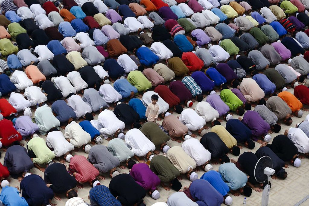 """A boy stands amongst Malaysian Muslims who are performing a special prayer called """"taraweeh"""" in Tuanku Mizan Zainal Abidin mosque ahead of the holy month of Ramadan in Putrajaya, outside Kuala Lumpur."""